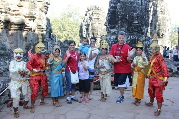 Family photo at the Banyon Temple with locals 