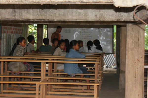 Cambodian schools are held in 2 sessions.  A morning and afternoon session with each session lasting 4 hours.  This school was taught by monks