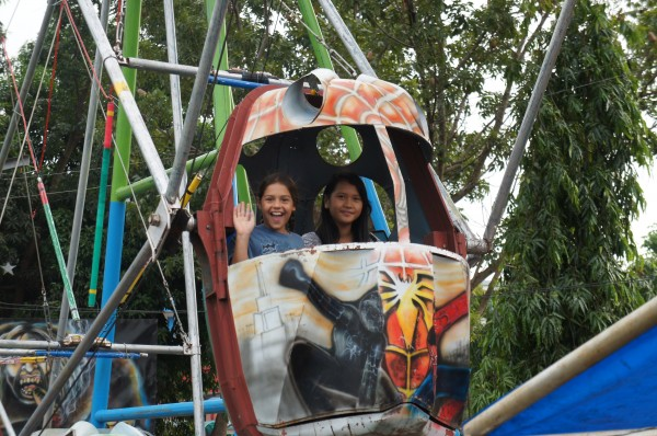 "Kalani with her new found cousin Kennybie on a ""Ferris Wheel"" at the fair"