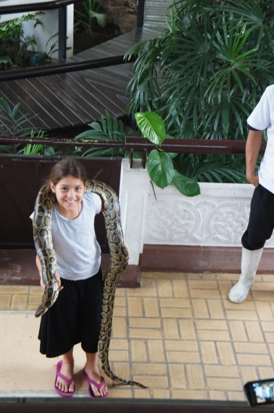 Kalani asked and answered questions at the snake farm and then willingly went up to have this python around her