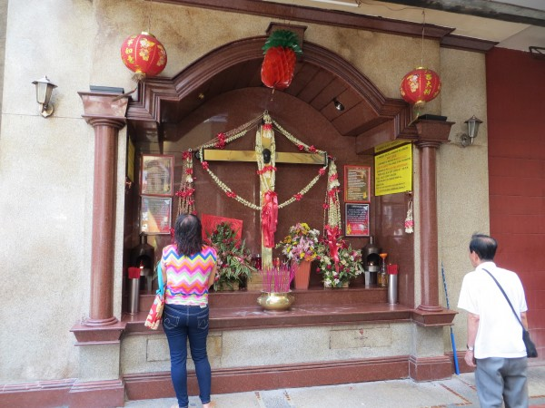 Most Chinese are Buddhist.  Most Filipinos are Catholics.  This place or worship intertwines both religions.