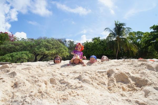 Powdery white sandy beaches at Club Paradise was perfect to bury the kids.