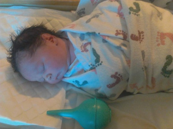 "Kina Ariel was born via C-section on September 23.  She weighed in at 7lbs 9oz and 19 3/4"" long."
