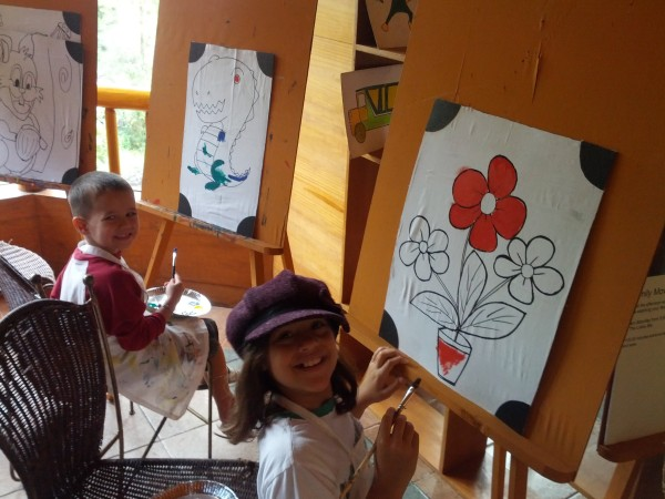 The kids each painted 3 art pieces at the hotel on a rainy day.