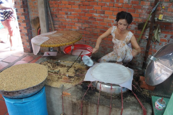 Along the Mekong Delta we saw this lady making rice paper for spring rolls.  We also saw them making coconut candy, extracting coconut oil, making rice cakes, etc.  It was a really awesome homeschool field trip!