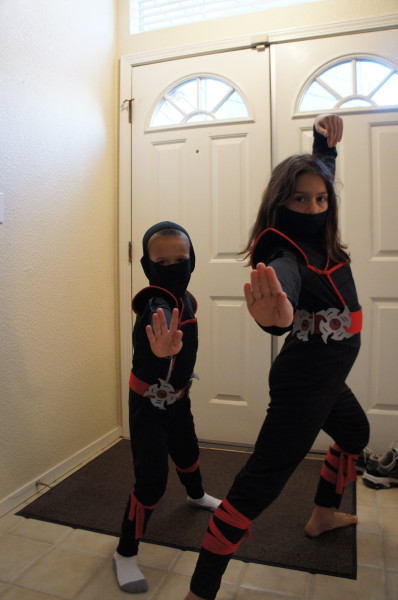 Ninjas are invading the house.  Both kids wanted to have the same ninja costume this year.