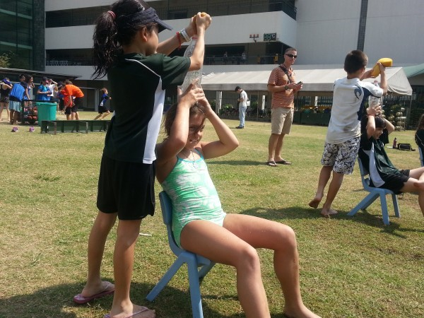 Having fun cooling off with her classmates