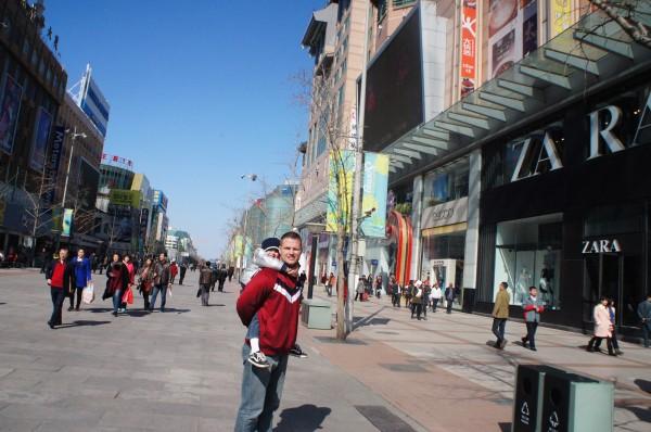 A pedestrian walking street full of stores. Many familiar store were seen