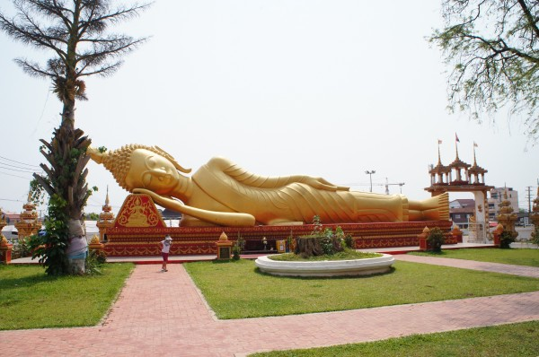 Laying Buddha at Pha That Luang reminded us of Thailand since they have one of these too.