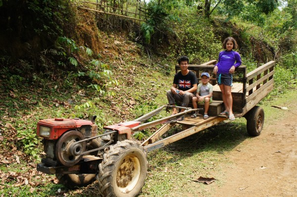 A Laoation tractor, also used as a means of transportation on the road for locals