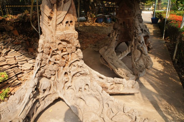 Cool carvings out of tree trunks at Ho Pra Keo