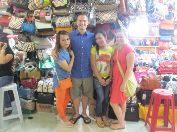 "A morning of shopping at Greenhills where we bought knock-off purses and other souvenirs. And of course they got to see ""lady-boys"""