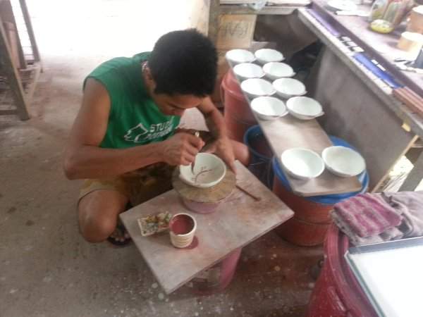 Hand painting each bowl