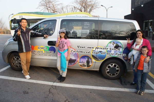 Us with our tour guide and his van.