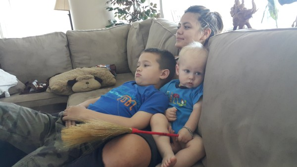 The boys quickly accepted our cousin and would spend a lot of time sitting with her on the couch.