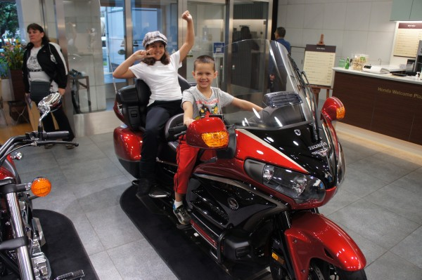 Mason really liked the motorcycles at the Honda showroom and wants this one.