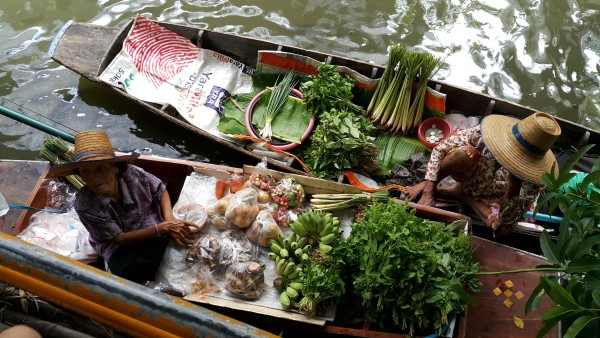 Klong Ladmayom Floating Market is more of a food area where you can buy food inside on solid ground, or outside by boat.