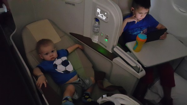 Philippine Air has a direct flight from Manila to Abu Dhabi that is nearly nine hours. To upgrade to business class is rather inexpensive for this flight, so that is what we did and even 16 month old Blake knows this is the preferred seating.