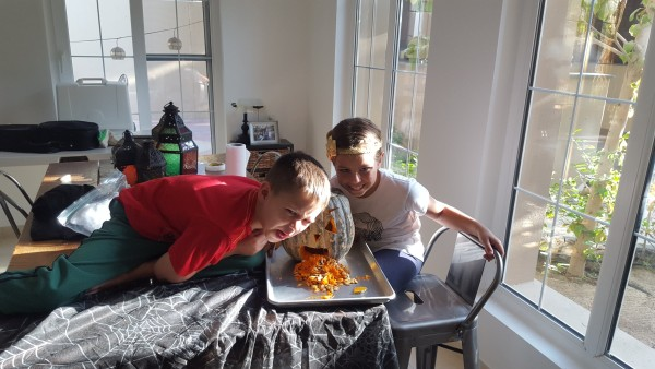 "Mason got to help carve a pumpkin since it was Halloween. Poor boy is 6 years old and that was his first time to ""carve"" a pumpkin."