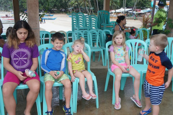 The kids waiting for the paper work to be completed before boarding the boat for the Underground River tour.