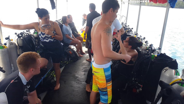 After getting only six hours of sleep, we were on the dive boat with about a dozen other divers. A dive boat is full of dive tanks and gear. The people were really nice, friendly and helpful as well.