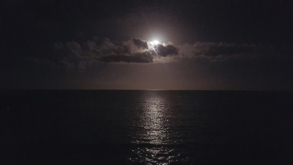 On the way back to the resort from our cousin's home we saw the moon shining over the ocean.