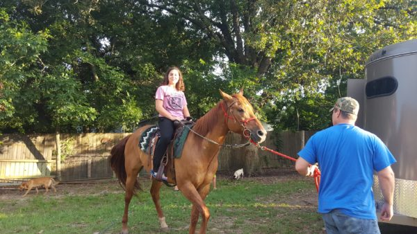 Kalani was the first one on a horse and she got the tallest horse.