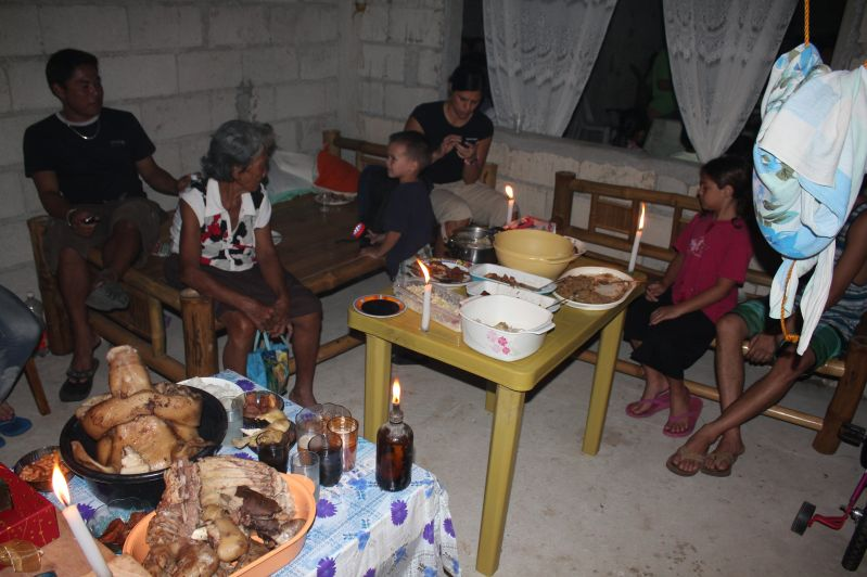 """Christmas dinner at our cousin's house warming party.  Family was put into a separate room while neighbors ate in the living room area.  There was also a """"brown out"""" during dinner so we ate by candle light."""