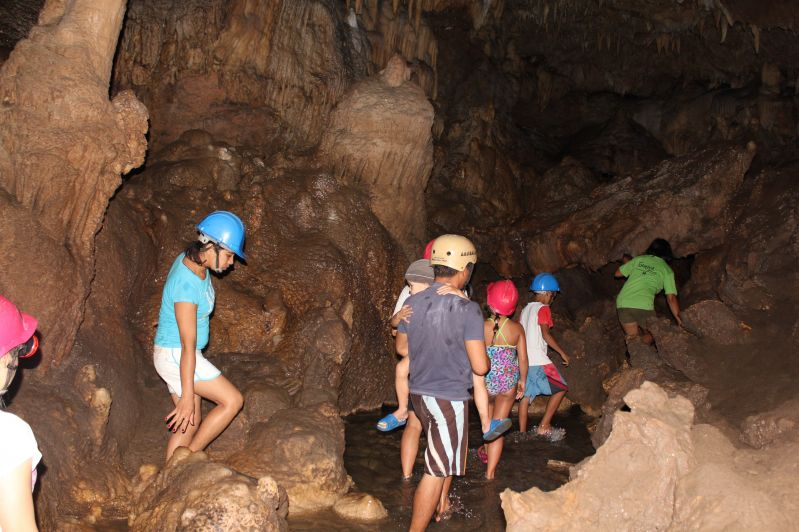 Cantabon Cave - Exploring where there really were not any rules (swimming and breaking off a stalactite for a souvenir) and our cousin carried Mason the whole time