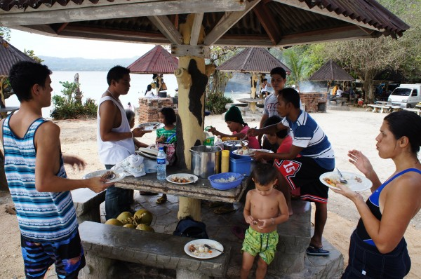 Enjoying lunch that our cousins provided and spending time at the beach
