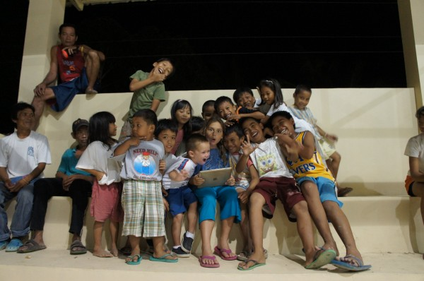 While the village volleyball game was going on, our kids were introducing the village kids to an iPad.  Not sure if more people were watching the volleyball game or the kids with the iPad