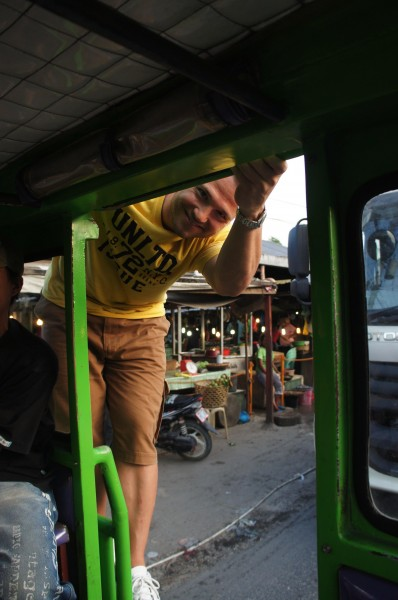 Matt has a bad back and bad knees.  So he opted to stretch out by standing on the back of the jeepney for most of the evening.