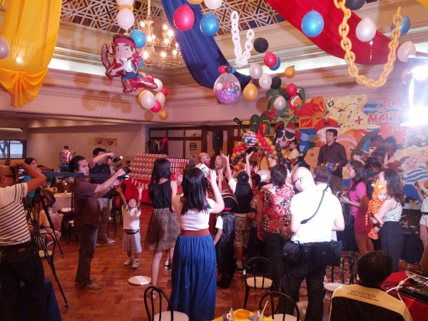 At the end of the party program there was a pinata...it is suppose to be for the kids, but there are a bunch of adults there to make sure their child gets a prize