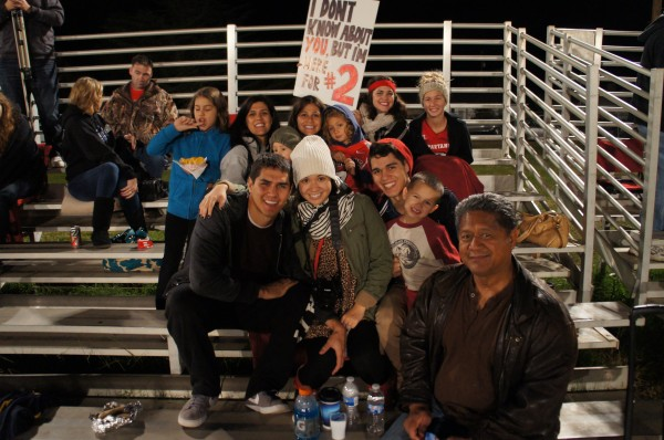 The family who watched Jeffrey's football game.  He scored 4 touchdowns that night!