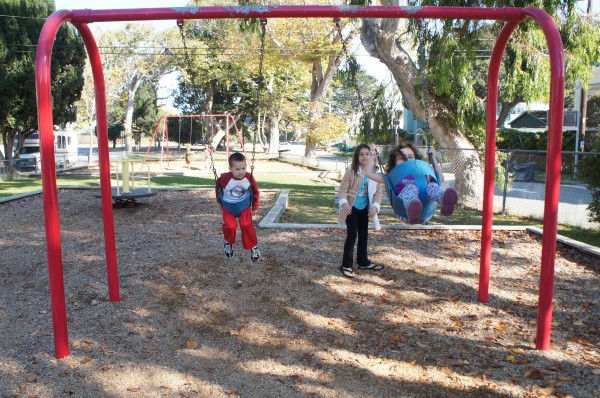 While waiting for Matt to arrive from the airport and the wedding to start, the kids enjoyed the nearby park and playing with their cousins.