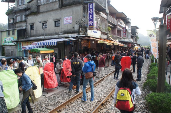 """We walked around Ping Hsi """"Pingxi"""" branch rail where we saw people """"play sky lantern."""" They would write sayings or wishes on a paper sky lantern and then release it."""