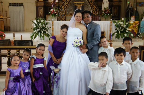 The bride (our cousin) and groom with the flower girls and escorts