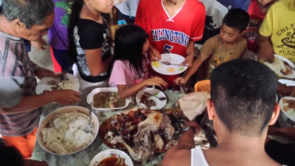 """The Filipinos love lechon and a """"free"""" meal"""