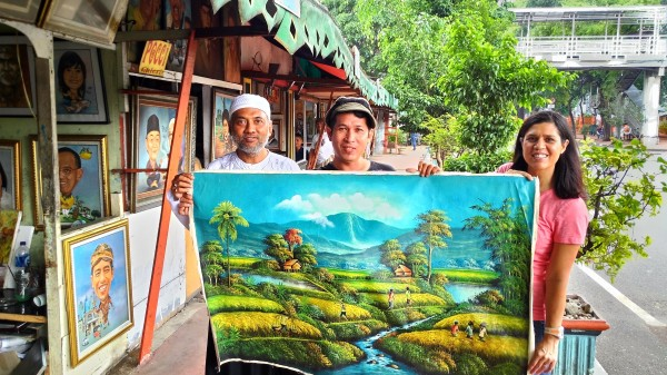 We bought this painting off the street from the artist (middle) on our way to another attraction