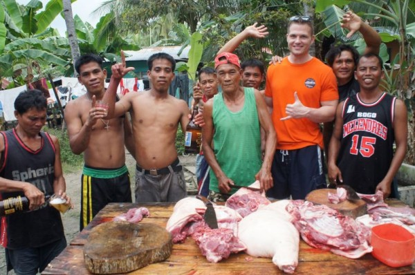 Also on Christmas Day the boys learned how to prepare lechon (pig)