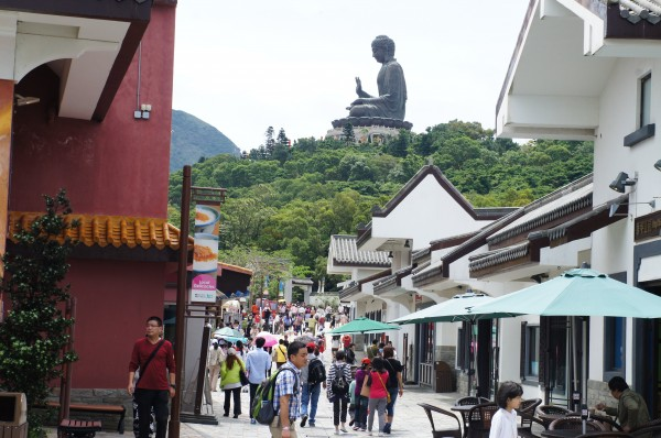 Off the cable car and we see Buddha in the distance and a bunch of western type of shops for the tourists