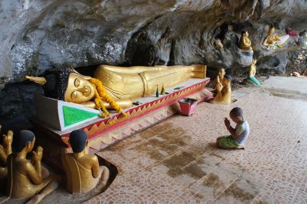 """Mason praying inside the """"Elephant Temple"""""""
