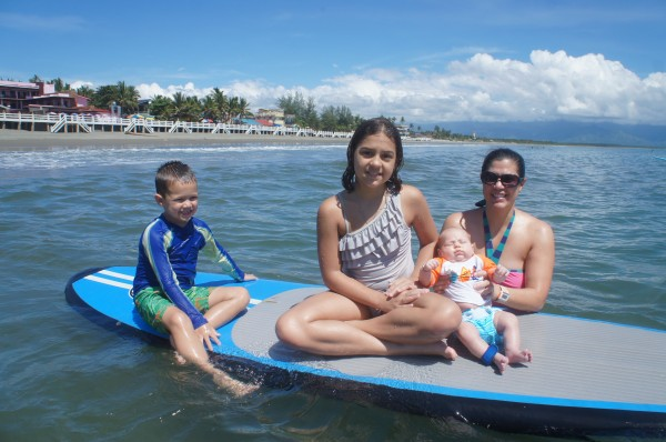 All of the kids on a surf board. This was Blake's first time in the ocean/pool & Kalani's first time back in the ocean after being stung by a jelly-fish