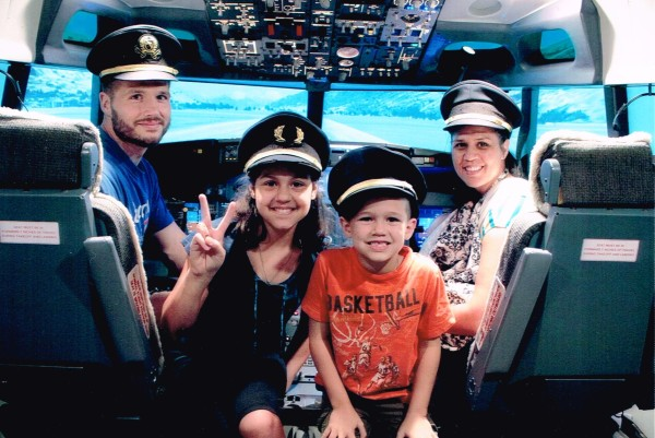 """We all were able to fly a plane with a real pilot in """"Flight Experience"""". We chose what airport we wanted to fly to and then were given different flying experiences (daytime, night time, bad weather, engine out)"""