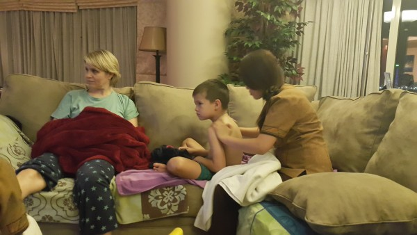We showed our aunt how we watch movies at home...by having a massage therapist massage your feet, back, arms, head, neck, etc.