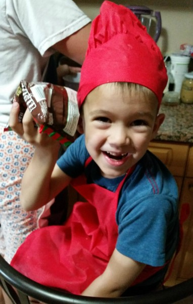 He loves to help out in the kitchen...mostly making chocolate chip cookies.