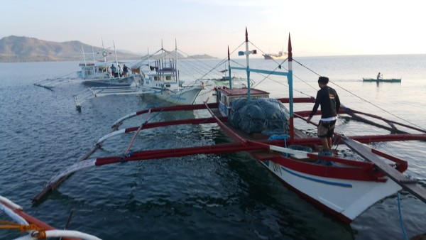 While traveling to return to Manila,  to remind us that we are in the Philippines, we had to walk through two boats in order to get to the dock where our van was waiting for us. Luckily no one fell in the water.