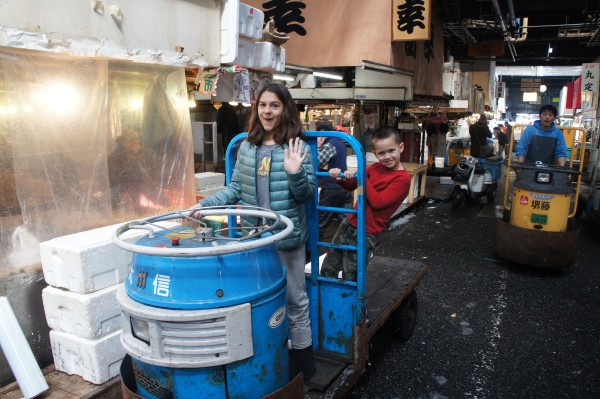 With over 60,000 employee at Tsukiji fish market, not many people get to ride on these trucks that they use to take the fish order from vendor to customer. But, we got lucky and a nice man let the kids jump on for a photo.