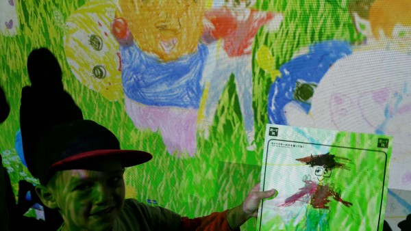 We went to the Science Center where TeamLab had a special exhibit. Mason colored a character on paper and then it got scanned and placed on the screen behind him. The character then interacts with other characters on the screen.