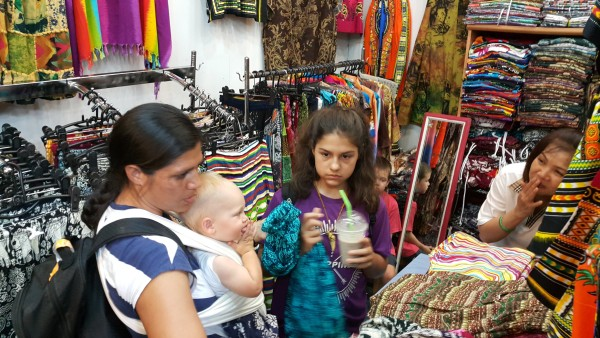 """We got to experience Chatuchak weekend market. Here we bought some """"Thailand"""" pants that really only tourist wear."""